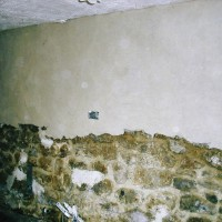 Interior wall plastering partially applied
