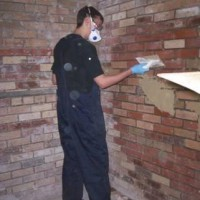 Jack Clarke, construction student at Kirby College, Merseyside - learning to apply plaster